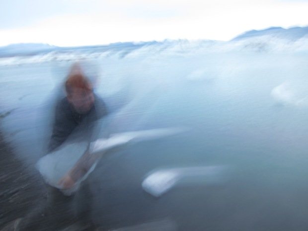 Throwing ice into Jökulsárlón