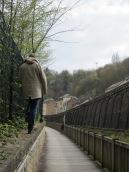 Near the foot of a railway bridge (that's all I got!)