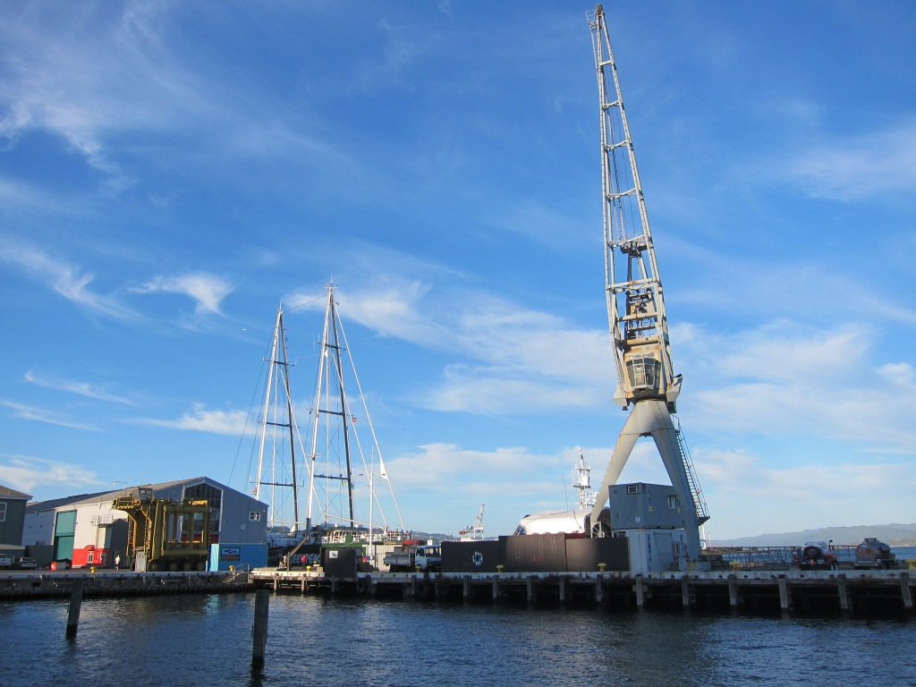 The tall masts of the Rainbow Warrior III stretch high above the Wellington harbour.